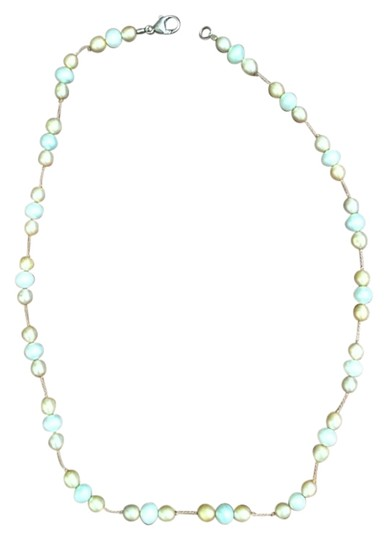 Preload https://item2.tradesy.com/images/light-mint-and-light-peach-beads-15-necklace-2089411-0-0.jpg?width=440&height=440