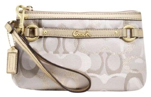 Coach Signature Metallic Wristlet in Gold