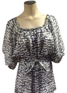MILLY Top white with green and brown pattern.