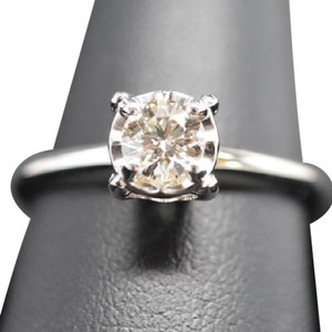 Other A 14K white gold solitaire diamond ring.