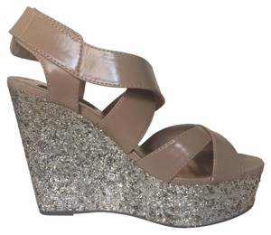 Material Girl Gold glitter topped w/ soft beige leather. Platforms