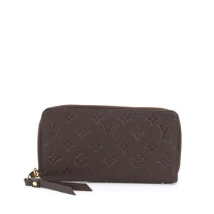 Louis Vuitton Leather Brown Clutch