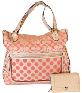 Coach Tote in Coral on off-white/ivory