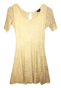 Rue 21 short dress Cream Scuba Open Back Backless Crochet Tan on Tradesy