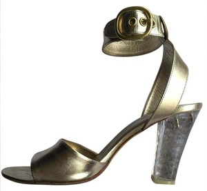 Coach Gold Pumps