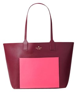 Kate Spade Leather Reversable Pink Jones Street Tote in mulled berry/pink confetti