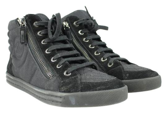 Preload https://img-static.tradesy.com/item/20930341/chanel-black-quilted-cc-high-top-sneakers-32cca3917-sneakers-size-us-7-regular-m-b-0-2-540-540.jpg