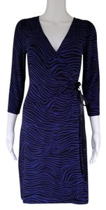 Express short dress Blue Wrap Stretch Animal Print 3/4 Sleeves on Tradesy