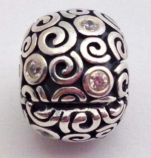 Preload https://img-static.tradesy.com/item/20930709/pandora-silver-wind-clip-clear-cz-and-sterling-bead-790962cz-new-charm-0-0-540-540.jpg