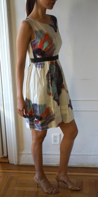Anthropologie short dress Base white with floral motif. Flowers on Tradesy