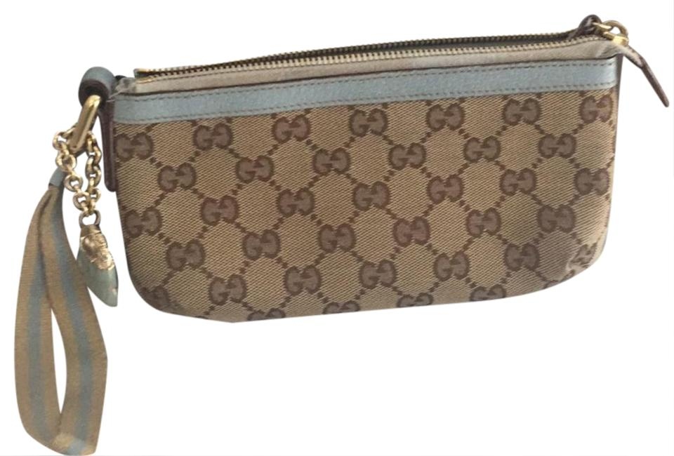 56eb26bd4 Gucci canvass wristlet Wristlet in tan with light blue and goldish accents  Image 0 ...