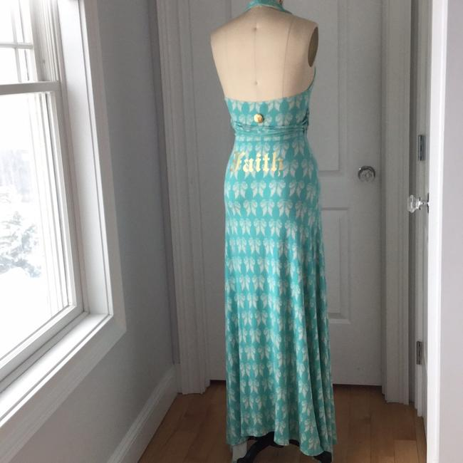 Light green with off white angel wings. Maxi Dress by Faith Connexion Image 6