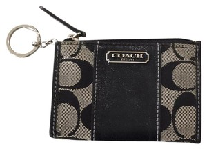 Coach Wristlet in Black and off white weave which looks like black and grey