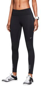Nike Women's Nike Shield Running Tights defy wind and rain with Nike Shield overlays and help lock in warmth with a brushed interior. Materials: 88% polyester, 12 spandex Style/Color: 693183-010