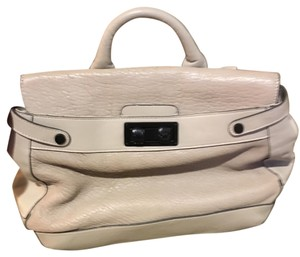 BCBGMAXAZRIA Satchel in tan/stone or camel color. all one color I just don't know the best answer. The tag says