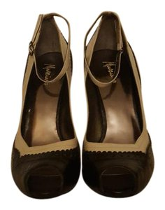 Marciano black and tan Pumps