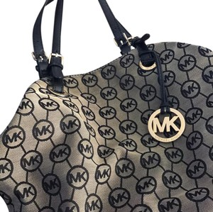 Michael Kors Tote in black and brown with gold accents medallion