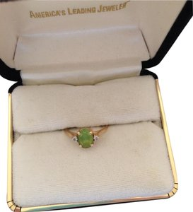 Other Peridot birthstone set in 14K Gold band w/2 small diamonds on side