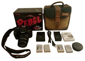 Canon Canon EOS Rebel T2i DSLR Camera w Lens, UV Filter, Case, Batteries