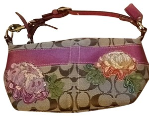 Coach Wristlet in Brown with pink details.