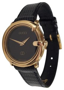 Gucci Black and Gold Watch