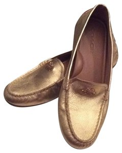 Authentic Coach Gold Moccasin Flats