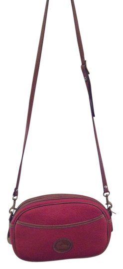 Preload https://item3.tradesy.com/images/dooney-and-bourke-and-classic-red-with-cognac-trim-leather-cross-body-bag-2095422-0-0.jpg?width=440&height=440
