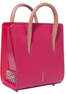 Christian Louboutin Louboutin Red Sole Leather Spiked Tote in raspberry, red, nude
