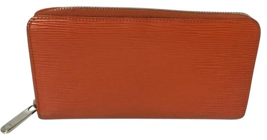 Preload https://item4.tradesy.com/images/louis-vuitton-orange-zippy-comes-with-box-wallet-2096018-0-3.jpg?width=440&height=440