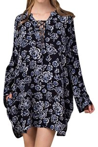 Southern Girl Fashion short dress Blue Lace Up Neckline Floral Printed Long Sleeve Swingy Classic Boho Chic on Tradesy