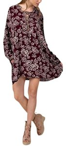 Southern Girl Fashion short dress Red Lace Up Neckline Long Sleeve Swingy Classic Boho Chic Floral Printed on Tradesy