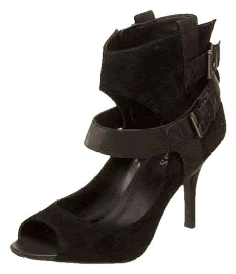 Preload https://item1.tradesy.com/images/guess-black-archer-pumps-size-us-85-2096680-0-0.jpg?width=440&height=440