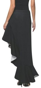 why Maxi Skirt Black outer. White interior shown in the ruffle split