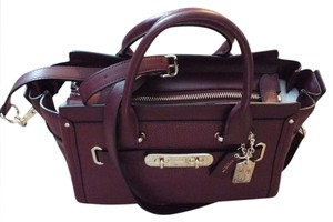 Coach 34816 888067653625 Swagger 27 Black Light Gold Satchel in Burgundy