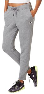 Nike Women's Nike Sportswear Modern Sweatpants. Get relaxed style for laid-back weekends or hard workouts with these Nike sweatpants, featuring tapered legs for a sporty look. Materials: 52% cotton, 29% polyester, 19% rayon. Style/Color: 803616-091