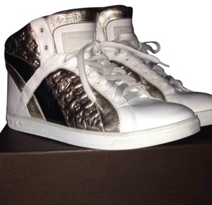 Louis Vuitton white with metallic monogram accent. Athletic