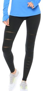 Nike Women's Nike Legend Tight Burnout Leggings. Materials: 59% cotton, 32% polyester, 9% spandex Style/Color: 725082-010