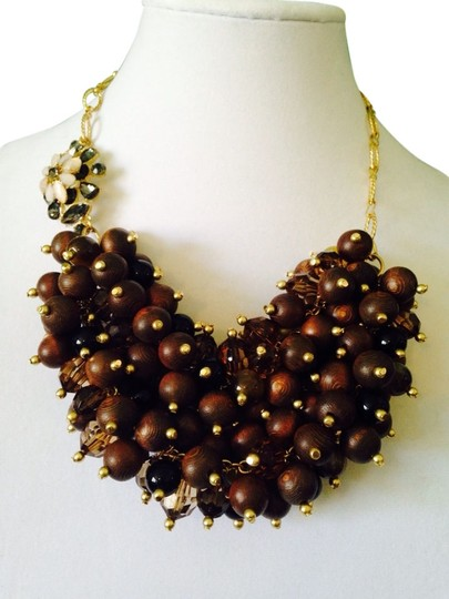 Preload https://img-static.tradesy.com/item/2097875/brown-wood-yellow-and-blackwhite-flower-wooden-bead-crystal-statement-necklace-0-0-540-540.jpg