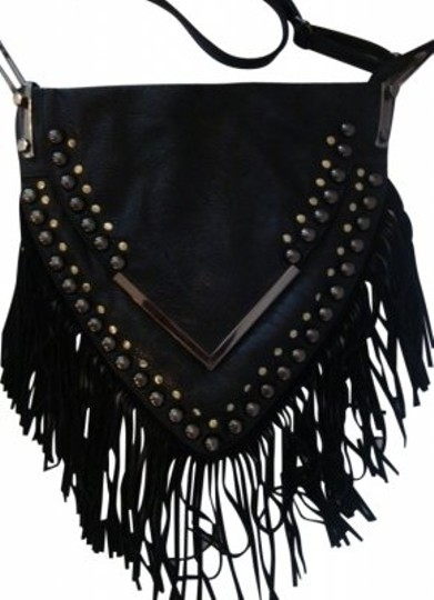 Preload https://item3.tradesy.com/images/triangle-shape-with-fringe-black-leather-shoulder-bag-20982-0-0.jpg?width=440&height=440