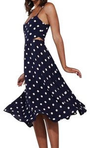 Reformation short dress blue with white polka dots on Tradesy