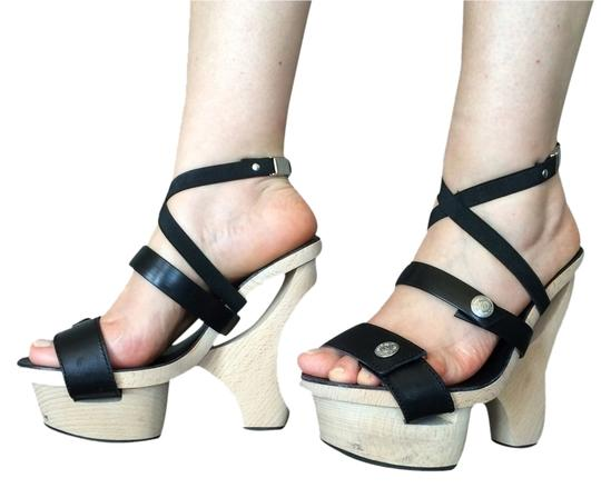 Preload https://img-static.tradesy.com/item/2098631/black-leather-sandals-size-us-75-regular-m-b-0-0-540-540.jpg