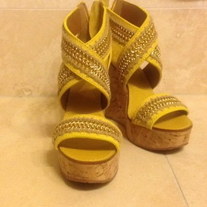 Tory Burch lemon yellow and golden chain Wedges