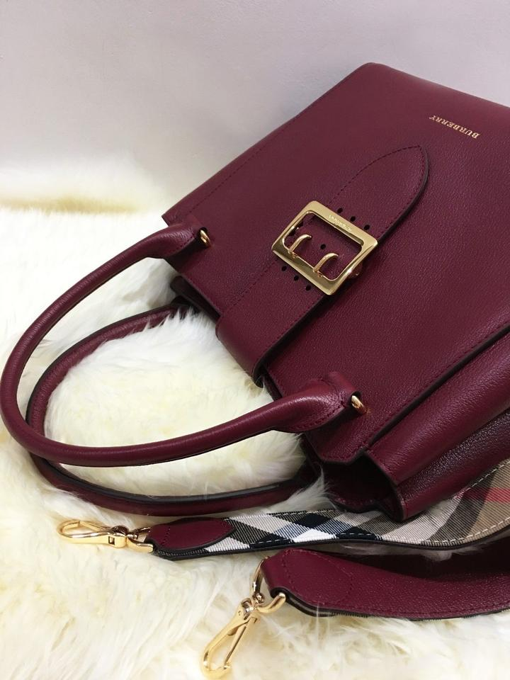 0be7f1c7516b Burberry Buckle Medium Tote Burgundy Red Grainy Leather Shoulder Bag -  Tradesy