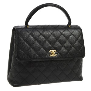 Chanel Satchel in Black quilted leather Kelly flap bag