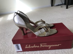Salvatore Ferragamo #salvatoreferragamo #goldsandals #weddingshoes #designerheels Gold Sandals