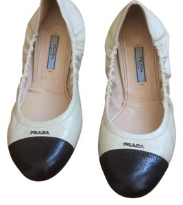 Prada White with Black cap toe Flats