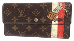 Louis Vuitton Monogramed Tin Tin/ Bell Boy long Sarah wallet
