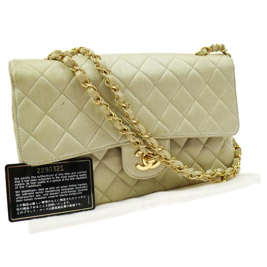 Preload https://img-static.tradesy.com/item/21001356/chanel-classic-flap-double-chain-beige-satin-shoulder-bag-0-5-540-540.jpg