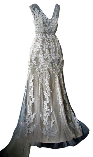 Preload https://img-static.tradesy.com/item/21001360/maggie-sottero-ivorylight-gold-lace-and-tulle-lucinda-4mt036-formal-wedding-dress-size-12-l-0-2-540-540.jpg