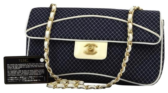 Preload https://img-static.tradesy.com/item/21001484/chanel-quilted-cotton-gold-chain-navy-blue-jersey-shoulder-bag-0-2-540-540.jpg